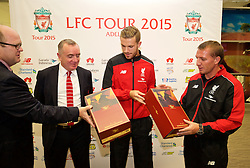 ADELAIDE, AUSTRALIA - Saturday, July 18, 2015: Liverpool's captain Jordan Henderson and manager Brendan Rodgers are presented with RM Williams boots, made in South Australia, during a press conference at Adelaide Airport ahead of a preseason friendly match against Adelaide United on day six of the club's preseason tour. (Pic by David Rawcliffe/Propaganda)