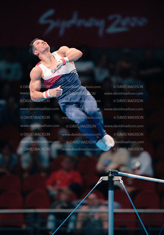 SYDNEY - SEPTEMBER 1:  John Roethlisger of the United States competes on the high bar during the Men's Gymnastics events of the Olympic Games on September 1 2000 in Sydney, Australia.  (Photo by David Madison/Getty Images)