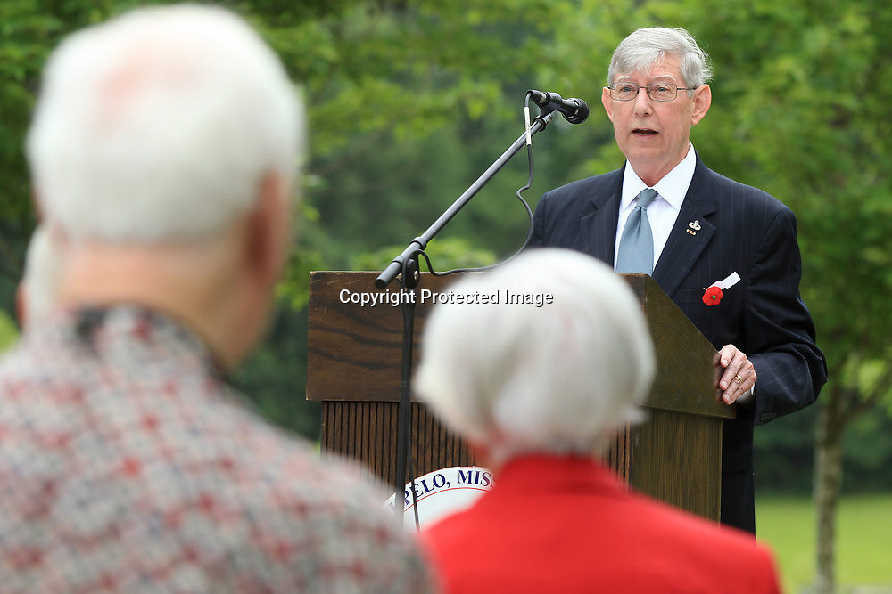 Speaker Dwight Dyess, US Army Col Retired, addresses those in attendance at Tupelo's Memorial Day Service at Veterans Park.