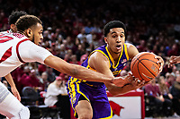 FAYETTEVILLE, AR - JANUARY 12:  Tremont Waters #3 of the LSU Tigers has the ball tipped by Daniel Gafford #10 of the Arkansas Razorbacks at Bud Walton Arena on January 12, 2019 in Fayetteville, Arkansas.  The Tigers defeated the Razorbacks 94-88.  (Photo by Wesley Hitt/Getty Images) *** Local Caption *** Tremont Waters; Daniel Gafford