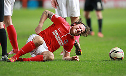 Charlton Athletic's Lawrie Wilson goes down injured - Photo mandatory by-line: Robin White/JMP - Tel: Mobile: 07966 386802 18/03/2014 - SPORT - FOOTBALL - The Valley - Charlton - Charlton Athletic v Bournemouth - Sky Bet Championship