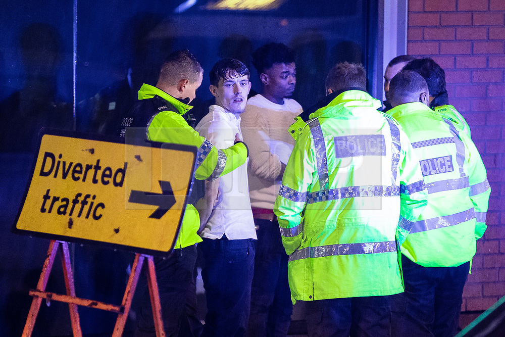"© Licensed to London News Pictures . 22/12/2018 . Manchester , UK . Police detain two men after a fight breaks out outside The Birdcage nightclub on Withy Grove . Revellers out in Manchester City Centre overnight during "" Mad Friday "" , named for historically being one of the busiest nights of the year for the emergency services in the UK . Photo credit : Joel Goodman/LNP"