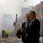 New Zealand Prime Minister John Key in Christchurch City Centre to survey the devastation after a Powerful earth quake ripped through Christchurch, New Zealand on Tuesday lunch time killing at least 65 people as it brought down buildings, buckled roads and damaged churches and the Cities Cathedral. Photo Tim Clayton