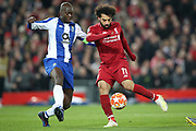Liverpool forward Mohamed Salah (11) and FC Porto midfielder Danilo Pereira (22) during the Champions League Quarter-Final Leg 1 of 2 match between Liverpool and FC Porto at Anfield, Liverpool, England on 9 April 2019.