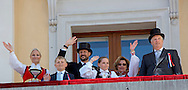 Oslo, 17-05-2016 <br /> King Harald and Queen Sonja. <br /> Princess Mette Marit and Prince Haakon and Princess Ingrid Alexandra and Prince Sverre Magnus  on the balcony of the Royal Palace viewing the  the children&rsquo;s parade on the Norwegian National day <br /> <br /> <br /> Photo: Royalportraits Europe/Bernard Ruebsamen