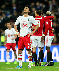 Maya Yoshida of Southampton looks dejected at full time as Manchester United players celebrate - Mandatory by-line: Matt McNulty/JMP - 26/02/2017 - FOOTBALL - Wembley Stadium - London, England - Manchester United v Southampton - EFL Cup Final