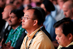 Attendees watch as Oracle CEO Larry Ellison announces four new cloud computing products and services including 12c, a cloud version of their core database software at the annual Oracle OpenWorld Conference.  Over 50,000 people will attend the 4-day event in San Francisco.