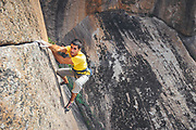 Climbers enjoying sunny summer day climbing auto protection routes in Placas del Halcon, La Pedriza, Spain