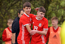 WREXHAM, WALES - Wednesday, October 30, 2019: Wales' Christopher Popov (L) celebrates scoring the second goal with team-mate Joel Cotterill during the 2019 Victory Shield match between Wales and Republic of Ireland at Colliers Park. (Pic by David Rawcliffe/Propaganda)