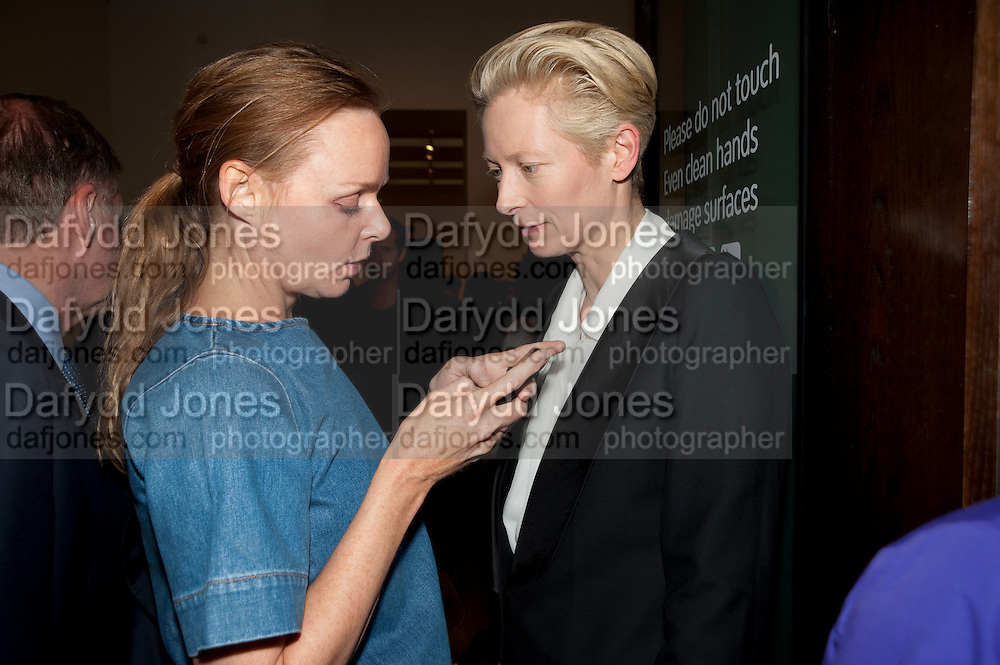 STELLA MCCARTNEY; TILDA SWINTON, A Living man declared Dead and Other Chapters. Taryn Simon. Tate Modern, London. 24 May 2011. <br /> <br />  , -DO NOT ARCHIVE-&copy; Copyright Photograph by Dafydd Jones. 248 Clapham Rd. London SW9 0PZ. Tel 0207 820 0771. www.dafjones.com.