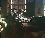 Color photo of a workshop in Russia 1910 by Sergey Mikhaylovich Prokudin-Gorsky 1863 – 1944, Russian photographer. He is known for his pioneering work in colour photography of early 20th-century Russia