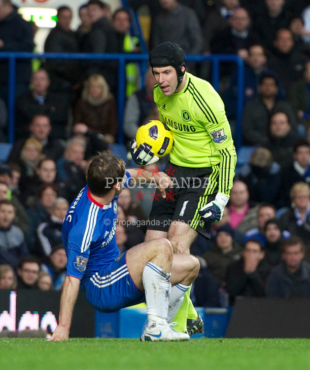 LONDON, ENGLAND - Sunday, February 6, 2011: Chelsea's Petr Cech clashes with team-mate Branislav Ivanovic during the Premiership match at Stamford Bridge. (Photo by Chris Brunskill/Propaganda)