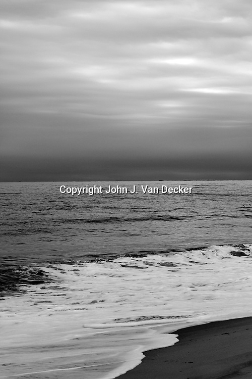 The beach at Cape May, New Jersey on a stormy day in back and white