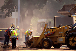 Stock photo of men with heavy machinery working to repair a street in Houston Texas