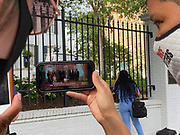 Pictured is activist Genesis Be, celebrating outside the Governors mansion, watching the live feed of Governor Tate Reeves signing the historic Bill HB1796 decommissioning the state flag and opening the door to a new flag without the Confederate emblem that has flown for 126 years.<br /> <br /> A Mississippi flag flies at the governors mansion in Jackson, Mississippi, U.S., June 30, 2020.  Photo©SuziAltman