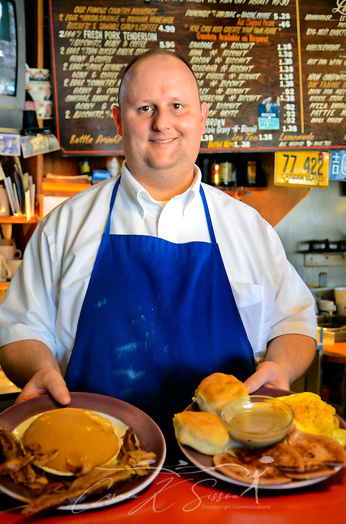 Ryan Whitfield shows off plates of breakfast food at Abe's Grill in Corinth, Mississippi March 5, 2012. The diner, which opened in 1974, claims to be the oldest diner on Highway 72 still operated by the original owners. (Photo by Carmen K. Sisson/Cloudybright)