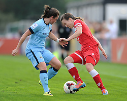 Bristol Academy Womens' Natalia Pablos Sanchon cuts insdie Manchester City Womens' Krystle Johnston - Photo mandatory by-line: Dougie Allward/JMP - Mobile: 07966 386802 - 28/09/2014 - SPORT - Women's Football - Bristol - SGS Wise Campus - Bristol Academy Women's v Manchester City Women's - Women's Super League