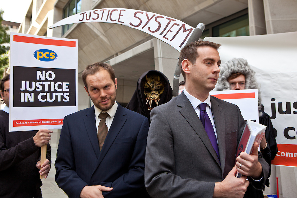 PCS union members present their report into proposed court closures to Sean Palmer, operations and performance director of Her Majesty's Court Service (HMCS). . The current Conservative government are proposing to close103 Magistrates Court and 54 County Courts in the UK as part of their current budget cut plans. PCS union members protest about job losses through court closures outside the Ministry of Justice (MOJ) building, central London. 15th September 2010.