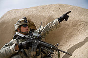 As their command post comes under attack, platoon Sargeant Nesmith, points out the enemy position to the rest of the 82nd Airborne, 1/508, Alpha Company, Third Platoon in Sangin, Helmand province, Afghanistan on Thursday, April 5, 2007. The firefight, less than 24 hours into the air assault on Sangin raged for over five hours.