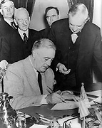 President Roosevelt signing the declaration of war on Japan December 1941