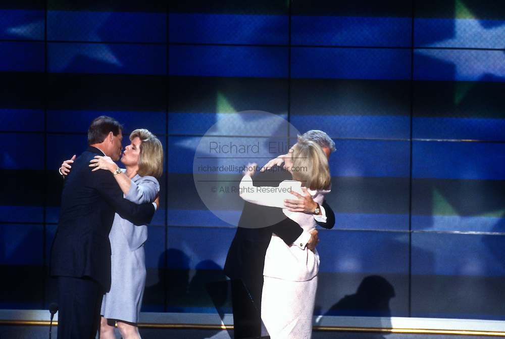 President Bill Clinton kisses wife Hillary with Vice President Al Gore and Tipper after his acceptance speech the Democratic National Convention August 29, 1996 in Chicago, IL.