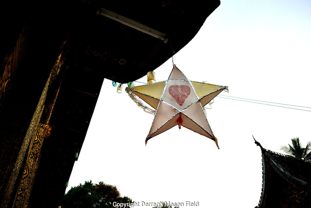 New years star hanging from the eves of a Wat