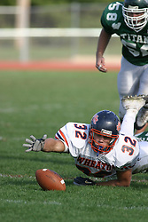 22 October 2005: Thunder Running Back Chaz Black lunges for the ball he loses while being tackled. The Illinois Wesleyan Titans posted a 23 - 14 home win by squeeking past the Thunder of Wheaton College at Wilder Field (the 5th oldest collegiate field in the US) on the campus of Illinois Wesleyan University in Bloomington IL