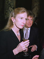 MR SIMON & the HON.MRS DICKINSON she is the sister of Lord Mancroft, at a party in London on 25th November 1997.MDR 49