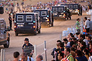 Police keep out non-authorized pilgrims form a restricted area before a mass celebrated by Pope Pope Benedict XVI at the base of Cuatro Vientos, eight kilometres (five miles) southwest of Madrid on August 21, 2011. The next World Youth Day festival of the Roman Catholic Church will be held in Rio de Janeiro in 2013, Pope Benedict XVI announced Sunday in Madrid