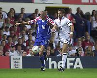 Photo. Glyn Thomas<br />England v Croatia - international friendly.<br />Portman Road, Ipswich. 20/08/2003.<br />Croatia's Ivica Mornar (L) holds off a challenge from Matthew Upson.