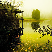 Calm water in lake with building