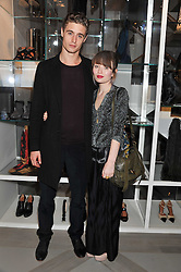 MAX IRONS and EMILY BROWNING at a party to celebrate the opening of the new Nicole Farhi global flagship store at 25 Conduit Street, London W1 on 19th September 2011.