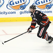Josh Manson #3 of the Northeastern Huskies with the puck during The Beanpot Championship Game at TD Garden on February 10, 2014 in Boston, Massachusetts. (Photo by Elan Kawesch)