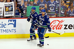 June 4, 2011; Vancouver, BC, CANADA; Vancouver Canucks left wing Daniel Sedin (22) and center Manny Malhotra (27) warm up before game two of the 2011 Stanley Cup Finals against the Boston Bruins at Rogers Arena. Vancouver defeated Boston 3-2 in overtime. Mandatory Credit: Jason O. Watson / US PRESSWIRE