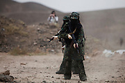 Female members of the Yemen Central Security Forces Special Forces Counter-Terrorism squad train with automatic weapons at a training range on the outskirts of Sana'a, Yemen April 14, 2010. Yemen continues efforts to improve the quality of its' armed forces as it faces a Houthi rebel movement in the North, a  separatist movement in its Southern territory, and Al Qaeda terrorist activity.