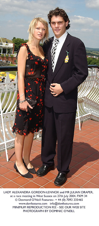 LADY ALEXANDRA GORDON-LENNOX and MR JULIAN DRAPER, at a race meeting in West Sussex on 27th July 2004.PXM 34