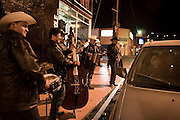 America, Mexico, Baja, Ensenada. A group of musicians play a song in the streets of the center of Ensenada, they wait for somebody that ask for one song , some times the cars comes and park there and ask for one song. - 15.03.2009, DIGITAL PHOTO, 50 MB, copyright: Alex Espinosa/Gruppe28.