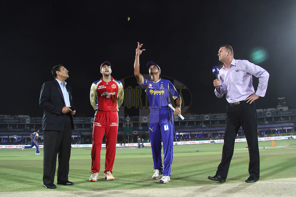 Rajasthan Royals captain Rahul Dravid tosses the coin as Royal Challengers Bangalore captain Daniel Vettori calls and Match Referee Ranjan Madugalle and Simon Doull look on during match 30 of the the Indian Premier League (IPL) 2012  between The Rajasthan Royals and the Royal Challengers Bangalore held at the Sawai Mansingh Stadium in Jaipur on the 23rd April 2012..Photo by Shaun Roy/IPL/SPORTZPICS