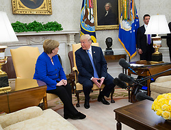 United States President Donald J. Trump meets with Chancellor Angela Merkel of Germany, in the Oval Office of the White House in Washington, DC, April 27, 2018. Credit: Chris Kleponis / Pool via CNP. 27 Apr 2018 Pictured: United States President Donald J. Trump meets with Chancellor Angela Merkel of Germany, in the Oval Office of the White House in Washington, DC, April 27, 2018. Credit: Chris Kleponis / Pool via CNP. Photo credit: Chris Kleponis - Pool via CNP / MEGA TheMegaAgency.com +1 888 505 6342