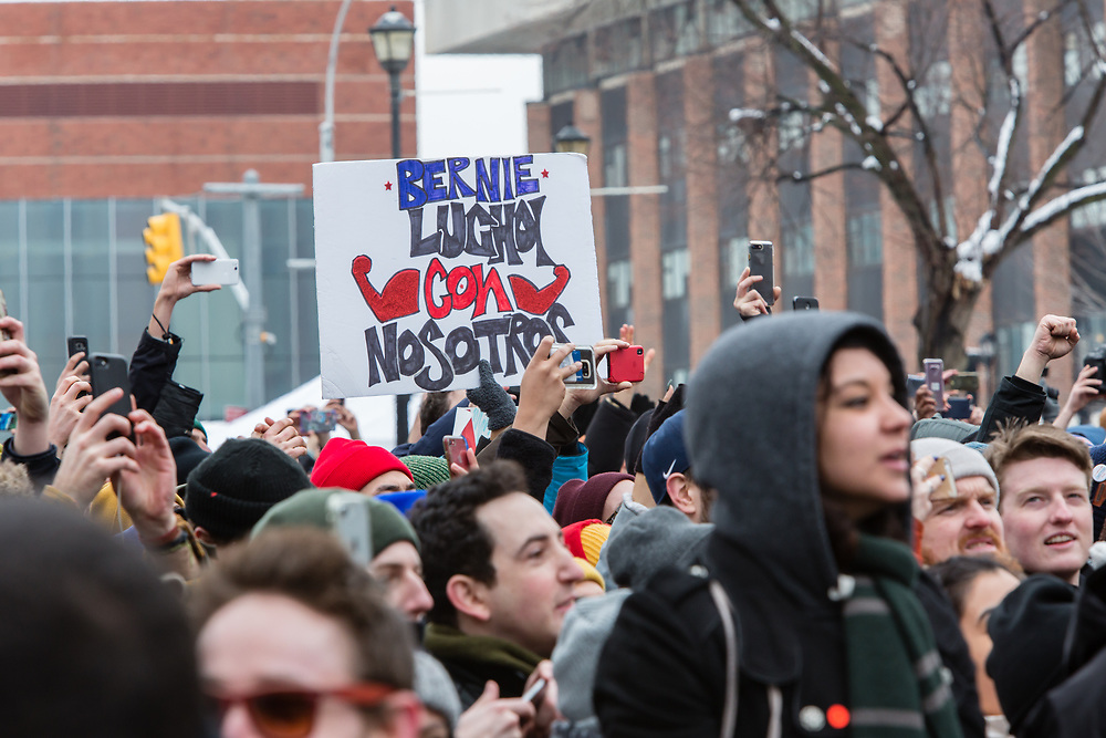 "Brooklyn, NY - 2 March 2019. A sign pm Spanish reads ""Bernie luchoi [sic.] con nosotros"" at Bernie Sanders' first rally for the 2020 presidential primary at Brooklyn College. Rough colloquial translation, ""Bernie struggles with us."""
