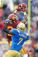 17 October 2012: Wide receiver (2) Robert Woods of the USC Trojans catches a pass while being covered by (7) Tevin McDonald of the UCLA Bruins during the second half of UCLA's 38-28 victory over USC at the Rose Bowl in Pasadena, CA.