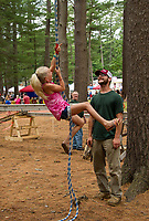 Lee French and Tom Carvalha watch as Carly climbs the rope to complete her time for the American Legion Post 49's obstacle course during Tilton-Northfield's Old Home Day on Saturday in Pines Park.  (Karen Bobotas/for the Laconia Daily Sun)