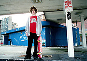 A teenage skateboarder, wearing a DC Shoes T shirt, Bristol, 2002