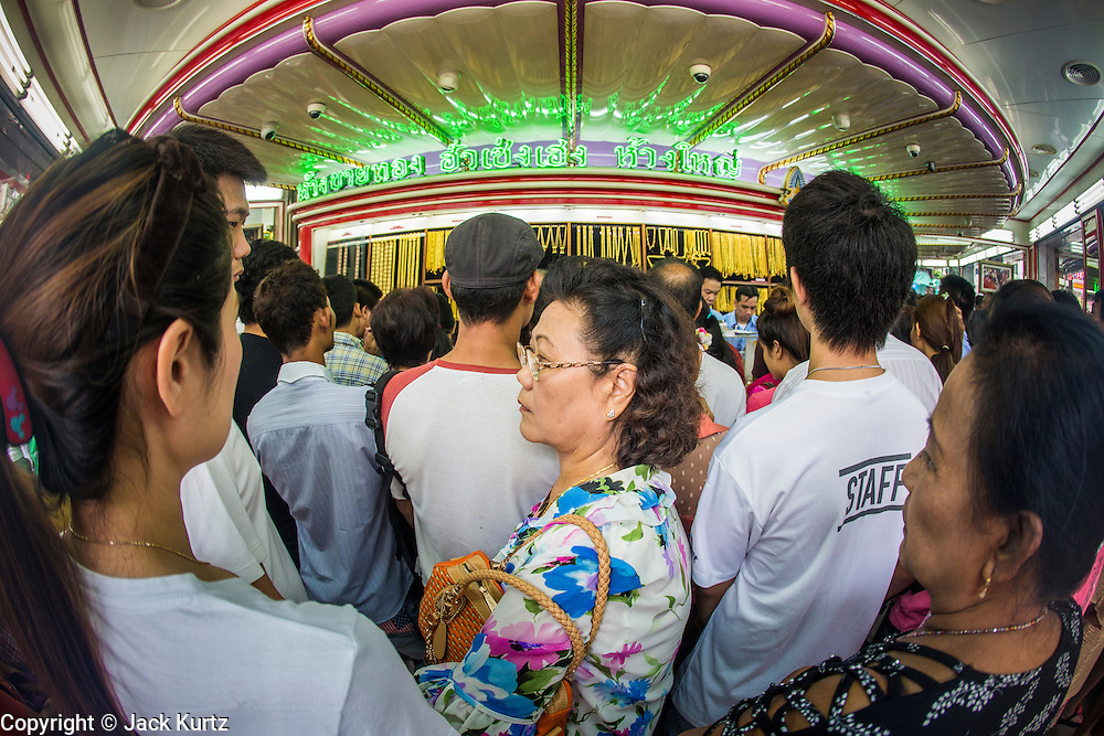 17 APRIL 2013 - BANGKOK, THAILAND:    Thais flocked to gold shops in Bangkoks's Chinatown this morning to buy gold. Wednesday was the first day most gold shops were open after a five day holiday weekend. Shops were closed Friday through Tuesday, when global gold prices dropped by more than 13% based on jitters that Cyprus might liquidate its gold stocks. The Thailand Futures Exchange (TFEX) suspended trading of all gold and silver futures for a short time Tuesday morning because of instability in the market. Gold is now about 22 percent below the record peak of $1,920.30 an ounce set in September 2011. Thais buy gold as both jewelry and an investment, a hedge against inflation and financial failures. Bangkok's Chinatown district is the center of Thailand's gold trade. PHOTO BY JACK KURTZ