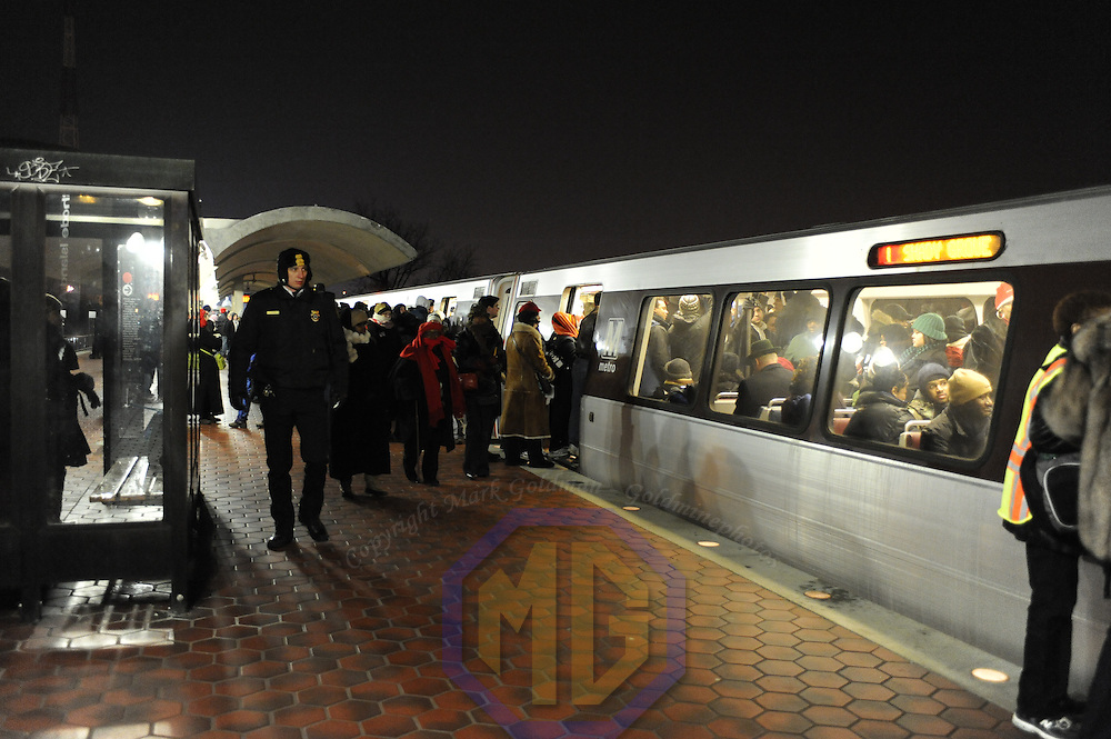 Passengers file into a Washington Metro subway car after having to vacate an over filled car at 4:40AM as too many riders tried to jam into the subway car for the ride into Washington, D.C. for the inauguration of Barack Obama as he is sworn in as the 44th President of the United States of America on Capitol Hill in Washington on January 20, 2009.    (Mark Goldman/ Goldmine Photos)