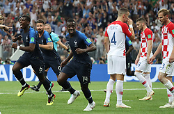 MOSCOW, July 15, 2018  France's Paul Pogba (1st L), Olivier Giroud (2nd L) and Blaise Matuidi (3rd L) celebrate after Croatia's Mario Mandzukic scored an own goal during the 2018 FIFA World Cup final match between France and Croatia in Moscow, Russia, July 15, 2018. (Credit Image: © Cao Can/Xinhua via ZUMA Wire)