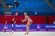 Agagulian Iasmina during qualifying at ribbon in Pesaro World Cup at Adriatic Arena on April 14, 2018. Iasmina is an Armenian rhythmic gymnastics athlete born in Yerevan in 2001.
