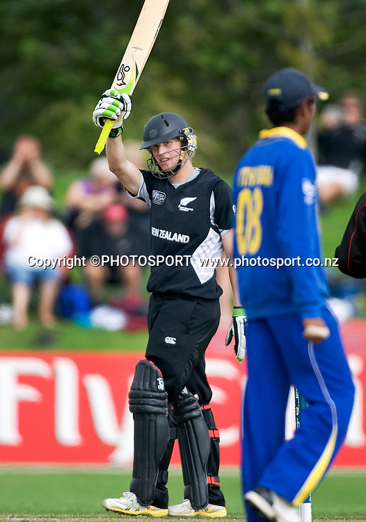 New Zealand batsman Harry Boam raises his bat to the New Zealand team applause after reaching his 50. New Zealand v Sri Lanka, U19 Cricket World Cup group stage match, Village Green, QEII, Christchurch, Wednesday 20 January 2010. Photo : Joseph Johnson/PHOTOSPORT
