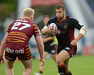 Matthew English of Huddersfield Giants and Tony Clubb of Wigan Warriors during the Betfred Super League match at the John Smiths Stadium, Huddersfield<br /> Picture by Richard Land/Focus Images Ltd +44 7713 507003<br /> 12/07/2018