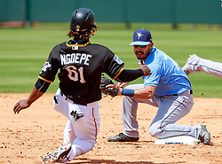 March 24, 2017 - Bradenton, Florida, USA-Pittsburgh Pirates second baseman Gift Ngoepe (61) gets caught steeling 2nd base in the 6th inning in a spring training game at LECOM Park. Del Mecum/CSM(Credit Image: © Del Mecum/CSM via ZUMA Wire)